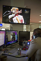 NITV Australian National Indigenous Television Story.<br /> A recorded indigenous concert plays on a editing suite in the offices of NITV.