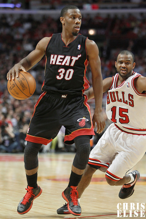 14 March 2012: Miami Heat point guard Norris Cole (30) drives past Chicago Bulls point guard John Lucas (15) during the Chicago Bulls 106-102 victory over the Miami Heat at the United Center, Chicago, Illinois, USA.
