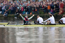 Cambridge Cox Ted Randolph celebrating in front of the crowds at Mortlake having just won the 156th University Boat Race against Oxford.