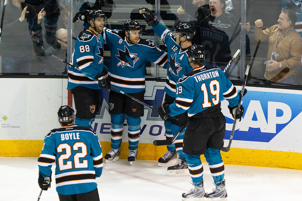 Dec 21, 2011; San Jose, CA, USA; San Jose Sharks center Joe Pavelski (8) is congratulated by teammates after scoring a goal against the Tampa Bay Lightning during the first period at HP Pavilion. Mandatory Credit: Jason O. Watson-US PRESSWIRE