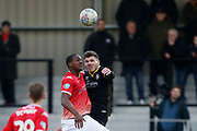 Crawley Town's Jordan Tunnicliffe and Salford City's Tom Elliot contest an aerial ball  during the EFL Sky Bet League 2 match between Salford City and Crawley Town at the Peninsula Stadium, Salford, United Kingdom on 8 February 2020.