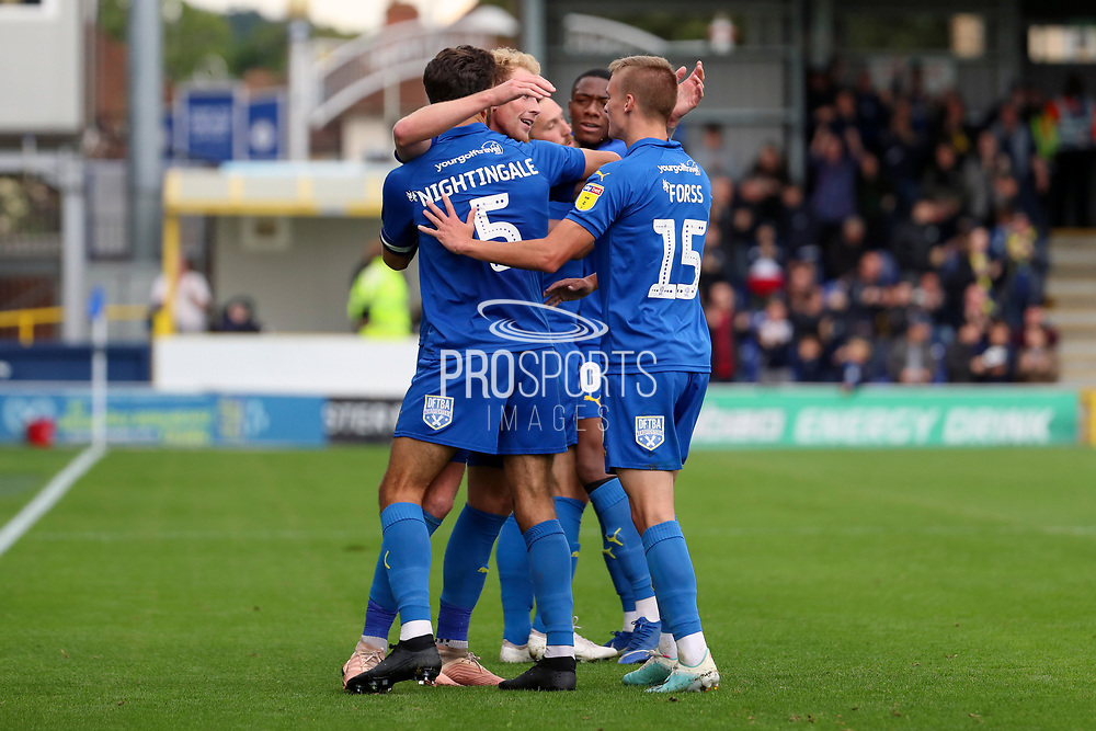 AFC Wimbledon midfielder Mitchell (Mitch) Pinnock (11) celebrating after scoring goal during the EFL Sky Bet League 1 match between AFC Wimbledon and Rochdale at the Cherry Red Records Stadium, Kingston, England on 5 October 2019.