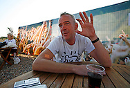 Norman Cook aka fat Boy Slim relaxes back stage before performing at his fourth Big Beach Boutique on Brighton seafront..