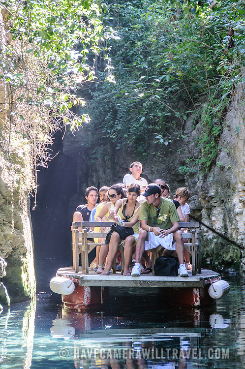 Tourists ride a boat through the narrow rivers running through Xcarat Maya theme park south of Cancun and Playa del Carmen on Mexico's Yucatana Peninsula.
