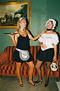 Two women in maid costumes one holding a tray, Posh at Addington Palace, UK, August, 2004