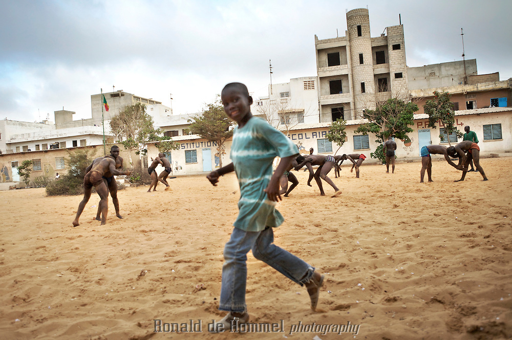 Many young boys in Senegal dream of a future in wrestling. It is one of the few escapes from a life of poverty in Dakar. ..African traditional wrestlers during the international championship of The Economic Community Of West African States (ECOWAS or CEDEAO) in Dakar Senegal. After losing the title to Nigeria last year, the Senegalese home team came out as champion again this time. The championship is prestigious, but commercial wrestling where the fighters are allowed to punch (lutte avec frappe) is more popular with audience and players. The prize money in those fights goes up to 150.000 Euros. The matches attract up to 60.000 spectators. Wrestling has become more popular than football in Senegal in recent years.