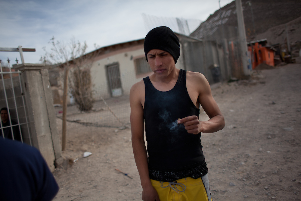 """El Mongo"" smokes marijuana outside his home in Ciudad Juarez, Mexico."