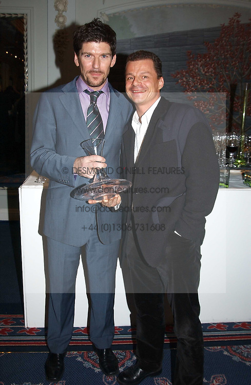 Left to right, RUSSELL NORMAN general manager of Zuma and RAINER BECKER owner of Zuma which was awarded the Best Restaurant of the Year Award at the Tatler Restaurant Awards in association with Champagne Louis Roederer held at the Four Seasons Hotel, Hamilton Place, London W1 on 10th January 2005.<br /><br /><br />NON EXCLUSIVE - WORLD RIGHTS