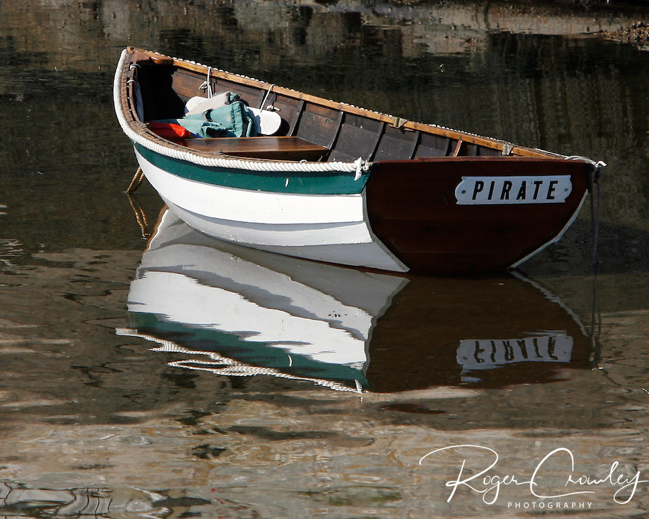 Roger Crowley / CrowleyPhotos.com..A dingy sits in shallow water in Georgetown Maine..