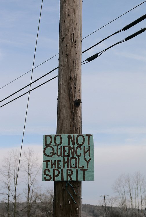 "Bible quotation on sign on telephone pole (""Do not quench the Holy Spirit"",1 Thessalonians 5:19)."