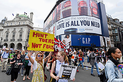 "© Licensed to London News Pictures. 29/05/2017. London UK. Demonstrators stage an ""Anti-Hunting March"" in central London, marching from Cavendish Square to outside Downing Street.  Protesters are demanding that the ban on fox hunting remains, contrary to reported comments by Theresa May, Prime Minister, that the 2004 Hunting Act could be repealed after the General Election.<br />  Photo credit : Stephen Chung/LNP"