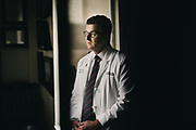 "BIRMINGHAM, AL – MARCH 1, 2018: Trauma surgeon Dr. Jeffery Kerby stands in his office at the University of Alabama at Birmingham. Kerby, a former Air Force surgeon, said he will never forget the first time he saw a victim of an assault rifle shooting 16 years ago in the Southern Philippines – the second front in the war on terror. The soldier's entry wound was a tiny hole in his outer thigh, but when he turned the soldier over to view the exit wound, he was surprised to see the man's inner thigh completely blown out. <br /> <br /> According to Kerby, assault style weapons are devastating to the human body, such that a surgeon can now quickly recognize the telltale signs of an AR-15 wound. The high energy bullet creates a blast wave which travels through the body, pushing tissue and organs aside violently. Patients that survive long enough to reach a hospital have little hope of recovering damaged organs. Too often, they bleed to death before even reaching an operating room. <br /> <br /> Despite being long retired from the military, Kerby is seeing AR-15 wounds more frequently at UAB hospital as a result of shootings on the streets of Birmingham. """"These weapons are meant to kill people,"" Kerby said."" ""Assault weapons have no place in civilian hands."" <br /> <br /> Since the Dickey Amendment of 1996, public funding for gun violence research has been prohibited, but Kerby believes there is a way to have a civilized discussion about gun violence research, without threatening second amendment rights. """"The two are not mutually exclusive,"" he said. <br /> <br /> CREDIT: Bob Miller for The New York Times"