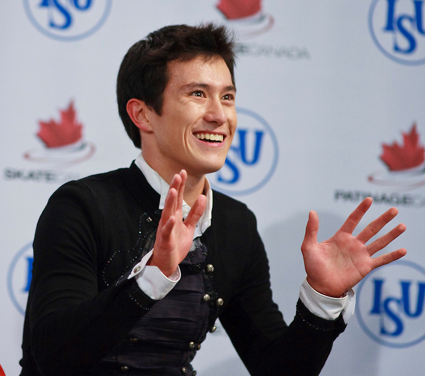 20101030 -- Kingston, Ontario -- Gold medalist Patrick Chan of Canada waves to the crowd as he awaits his marks following his free skate at Skate Canada International in Kingston, Ontario, Canada, October 30, 2010. <br /> AFP PHOTO/Geoff Robins