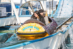 © Licensed to London News Pictures. 20/10/2016. Brighton, UK. Members of the public enjoy the sunshine by taking a ride on the Big Splash water attraction on the Brighton and Hove Palace Pier. Photo credit: Hugo Michiels/LNP