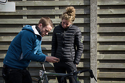 Willeke Knol configures her cycle computer at Dwars door Vlaanderen 2017. A 114 km road race on March 22nd 2017, from Tielt to Waregem, Belgium. (Photo by Sean Robinson/Velofocus)