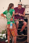 Men preparing food outside a mobile home at Middle East Tek, Wadi Rum, Jordan, 2008