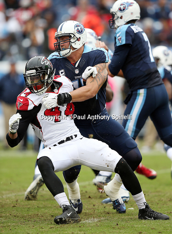 Atlanta Falcons defensive end Vic Beasley Jr. (44) tries to work his way around a block by Tennessee Titans offensive tackle Taylor Lewan (77) during the 2015 week 7 regular season NFL football game against the Tennessee Titans on Sunday, Oct. 25, 2015 in Nashville, Tenn. The Falcons won the game 10-7. (©Paul Anthony Spinelli)