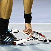 Fernando Gonzalez of Chile picks up his racquet after breaking it during his fourth round match against Andy Roddick of the US at the Australian Open Tennis Tournament in Melbourne, Australia, 25 January 2010. Roddick won in five sets.