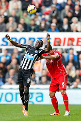 Papiss Demba Cisse of Newcastle United and Dejan Lovren of Liverpool compete in the air - Photo mandatory by-line: Rogan Thomson/JMP - 07966 386802 -01/11/2014 - SPORT - FOOTBALL - Newcastle, England - St James' Park - Newcastle United v Liverpool - Barclays Premier League.