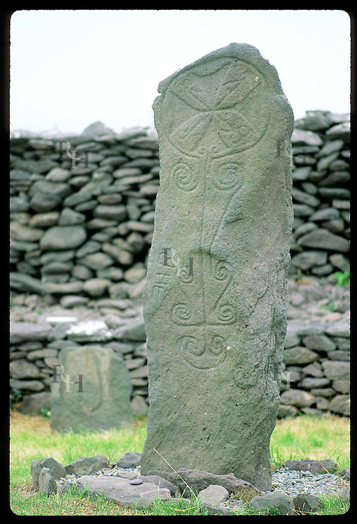 Early Christian pillar bears Celtic designs at Reasc monastic ruins (5th-c); Dingle Peninsula. Ireland