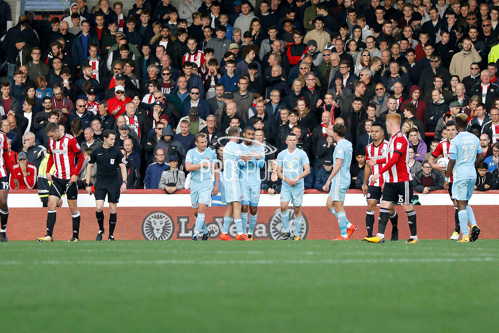 Sunderland players celebrate a goal from Sunderland forward Lewis Grabban (11) (score 1-3) during the EFL Sky Bet Championship match between Brentford and Sunderland at Griffin Park, London, England on 21 October 2017. Photo by Andy Walter.