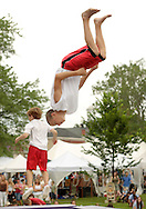 Goshen, NY - Two members of the Skyriders, an acrobatic trampoline team, warm up before performing at the Great American Weekend festival on July 5, 2008.
