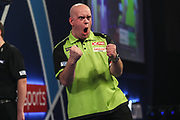 Michael van Gerwen wins the first set and celebrates during the World Darts Championships 2018 at Alexandra Palace, London, United Kingdom on 30 December 2018.