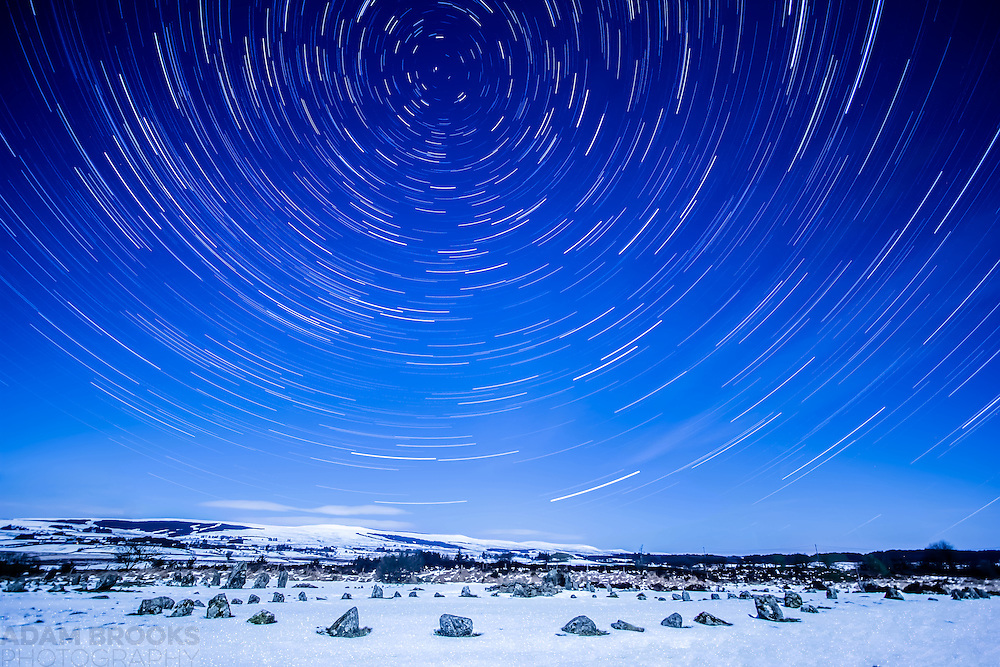 Star trails at Beaghmore Stone Circles up in the Sperrin Mountains on a cold, snowy night under a near Full Moon. The Full Moon has lit up the landscape beautifully giving the effect of it being daylight, whilst also giving a sparkly effect to the snowy ground as it moved over the duration that the pictures were taken.<br />