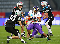 06.07.2013, Tivoli Stadion, Innsbruck, AUT, EFL Finale, Eurobowl XXVII, Swarco Raiders Tirol (AUT) vs Raiffeisen Vikings Vienna (AUT), im Bild Alexander Achammer, (SWARCO Raiders Tirol, DB, #30) und  Jesse Lewis, (Raiffeisen Vikings Vienna, RB, #28)  // during the Eurobowl XXVII between Swarco Raiders Tirol (AUT) and Raiffeisen Vikings Vienna (AUT) at the Tivoli Stadion, Innsbruck, Austria on 2013/07/06. EXPA Pictures © 2013, PhotoCredit: EXPA/ Thomas Haumer