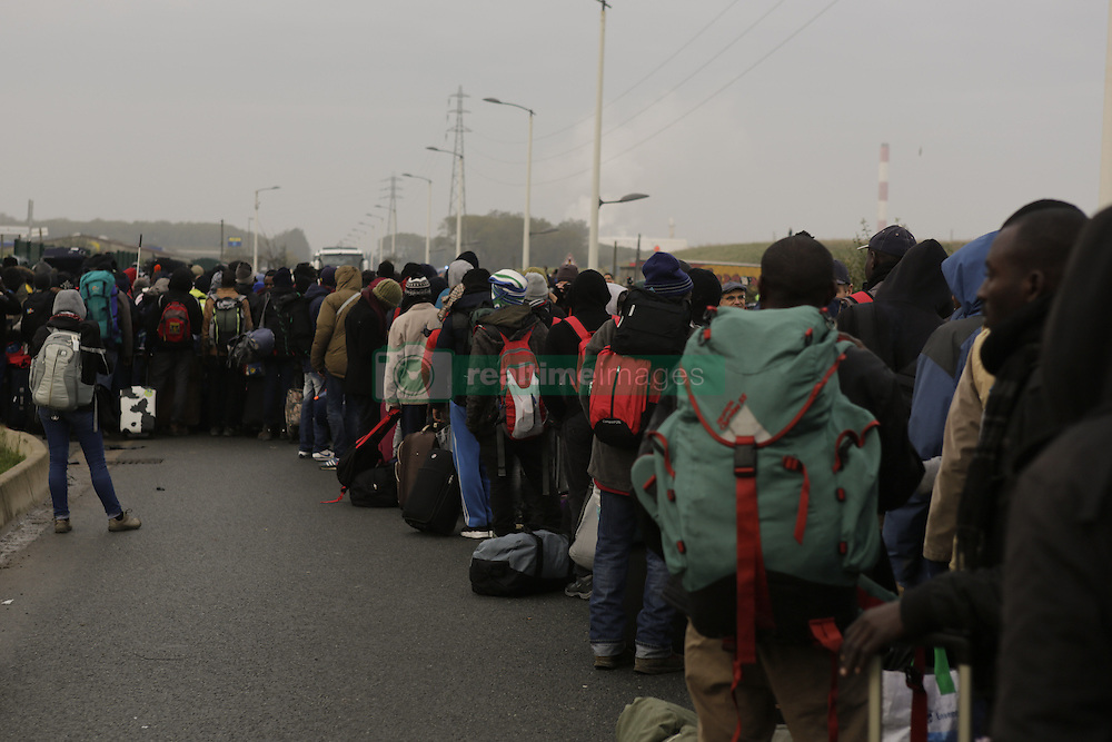 October 24, 2016 - Calais, Nord-Pas-de-Calais-Picardie, France - Refugees queue outside the Reception and Orientation Centre near the Jungle, from where he will be distributed to one of the different centres in France. The French state has started processing the inhabitants of the Jungle refugee camp in Calais and distribute them to centres around France. Not all of the 6 to 10 thousand refugees living in the Jungle (according to different estimates) are expected to leave voluntarily and some have already disappeared. (Credit Image: © Michael Debets/Pacific Press via ZUMA Wire)