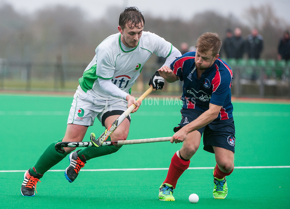 Canterbury's Stuart Goodman is tackled by Ross Hall of Brooklands. Canterbury v Brooklands - Now: Pensions Hockey League Premier Division, Polo Farm, Canterbury, UK on 28 February 2015. Photo: Simon Parker