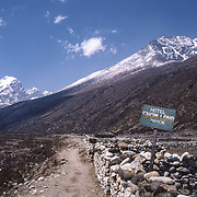Pheriche, Nepal, Hotel Snow Land guest house sign and trail toward Everest Base Camp