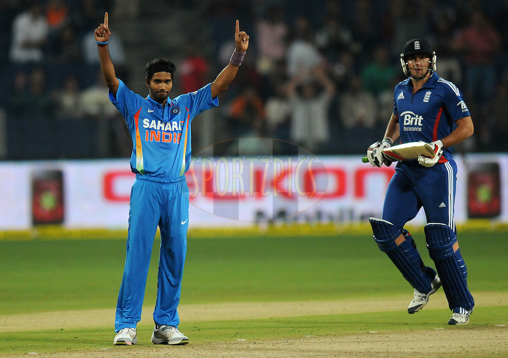 Ashok Dinda of India celebrates the wicket of Tim Bresnan of England during the first Airtel T20 Match between India and England held at Subrata Roy Sahara stadium in Pune on the  20th December 2012..Photo by  Pal Pillai/BCCI/SPORTZPICS .