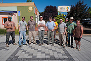 Volunteer work party completes laying pavers for the pervious pavement parking lot (L-R): Bo Lassiter, Josh Lighthipe , Mitchel Frister, Adam Zucker, Charles Heying, Pete Wilson , Dustin Elmore, Rick Wasserloos, Gary Riggs, Fred Davis.  Café au Play at Tabor Commons, a project of the Southeast Uplift Neighborhood Coalition (SEUL) and volunteers from Portland's Mt Tabor neighborhood.