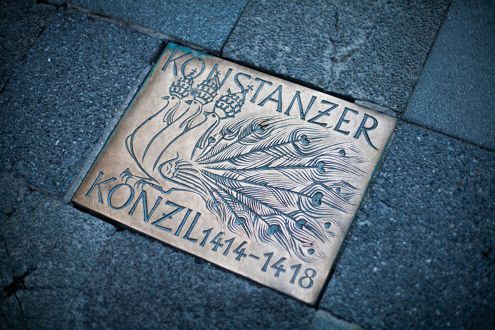 Memorial plate in the floor of a shopping street in the city of Constance reminding The Council of Constance which is the 15th century ecumenical council recognized by the Roman Catholic Church, held from 1414 to 1418. The council ended the Western Schism, by deposing or accepting the resignation of the remaining papal claimants and electing Pope Martin V.