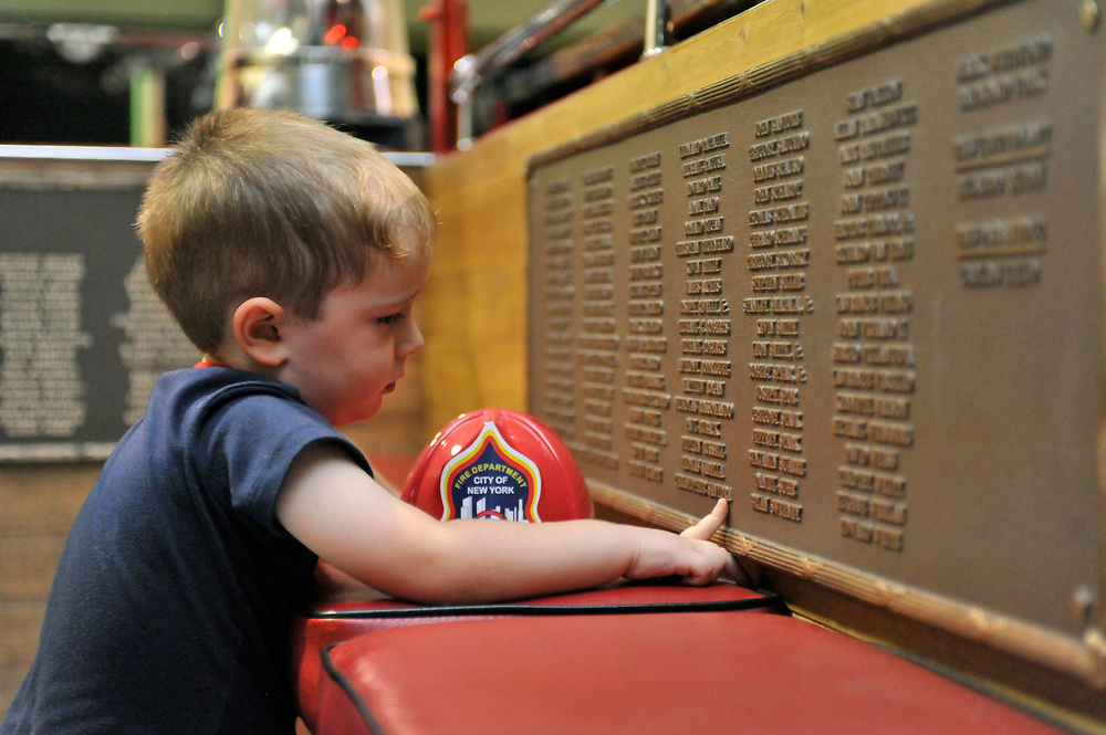 3.5 yo Willie C. Brown, Jr. descendant to a long line of Fire Fighters, in the memorial Engine 343. Fire Station No. 5, Fayetteville, North Carolina. Sep 14, 2011. NYC- SC. USA.