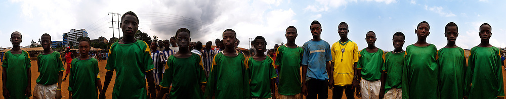 The under 14 football team, The Young Stars of Kroo Bay posing after a match, Kroo Bay, Freetown, Sierra Leone.