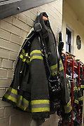 26 February 2013. Bronx, New York. Engine Co. 73/Hook & Ladder 42 at 655-659 and 661 Prospect Ave., the Bronx. A fireman's coat hangs by the staircase of Engine Co. 73, which was made a New York City landmark on February 12, 2013. Unlike some of the other firehouses that were landmarked that day, Co. 73 is still a functioning fire station. 2/26/13. Photograph by Nathan Place/CUNY Journalism Photo.