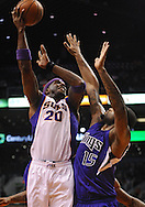 Dec. 17, 2012; Phoenix, AZ, USA; Phoenix Suns center Jermaine O'Neal (20) puts up the ball during the game against the Sacramento Kings center DeMarcus Cousins (15) in the second half at US Airways Center. The Suns defeated the Kings 101-90.  Mandatory Credit: Jennifer Stewart-USA TODAY Sports