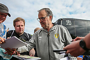 Leeds United manager Marcelo Bielsa signs autographs during the Pre-Season Friendly match between Forest Green Rovers and Leeds United at the New Lawn, Forest Green, United Kingdom on 17 July 2018. Picture by Shane Healey.