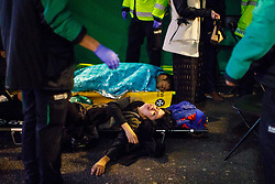 © Licensed to London News Pictures. 01/01/2017. London, UK. Intoxicated revellers are helped by ambulance crews as people celebrate the New Year in central London during the first hours of 2017 on January 1. Photo credit: Tolga Akmen/LNP