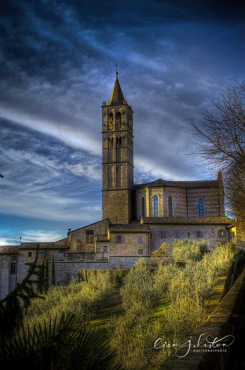 Chiesa di Santa Chiara | Basilica of St. Clare of Assisi from the via Borgo Aretino shows a grove of olive trees.