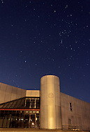 Middletown, New York  - Stars shine in the night sky above a building on March 11, 2012. The constellation Orion is at upper right.