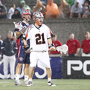 Ethan Vedder #21 of the Denver Outlaws and Paul Rabil #99 of the Boston Cannons are seen in the rain during the game at Harvard Stadium on May 10, 2014 in Boston, Massachusetts. (Photo by Elan Kawesch)