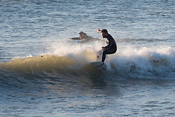 © Licensed to London News Pictures. Aberystwyth Wales UK, Wednesday 10 October 2018<br /> <br /> UK Weather: Surfers enjoying a glorious, and unusually warm,  autumn evening at the seaside in Aberystwyth on the west wales coast, after a day of exceptionally warm sunshine for much of the UK, with temperatures reaching the 20's celsius. The weather is set to change dramatically on Friday and Saturday however, with a band of torrential rain bringing the risk of flooding to much of Wales and North West  England<br /> Photo  credit: Keith Morris / LNP