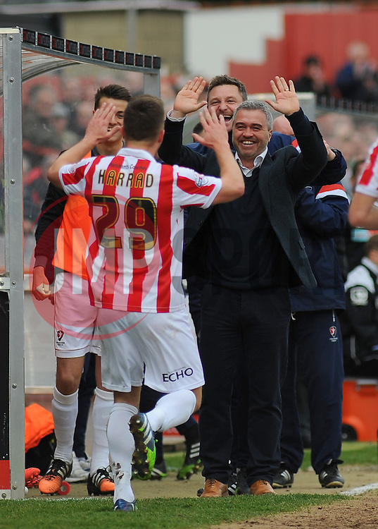 Cheltenham Town's Shaun Harrad Celebrates his goal with Cheltenham Town Manager, Russell Milton - Photo mandatory by-line: Nizaam Jones - Mobile: 07966 386802 - 28/02/2015 - SPORT - Football - Cheltenham- Whaddon Road - Cheltenham Town v Tranmere Rovers - Sky Bet League Two