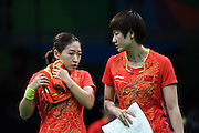 RIO DE JANEIRO, BRAZIL - AUGUST 15: <br /> <br /> Ding Ning (R) and Li Xiaoxia of China compete against Zhou Yihan and Feng Tianwei of Singapore during the Table Tennis Women\'s Team Round Semi Final between China and Singapore during Day 10 of the Rio 2016 Olympic Games at Riocentro - Pavilion 3 on August 15, 2016 in Rio de Janeiro, Brazil. <br /> ©Exclusivepix Media