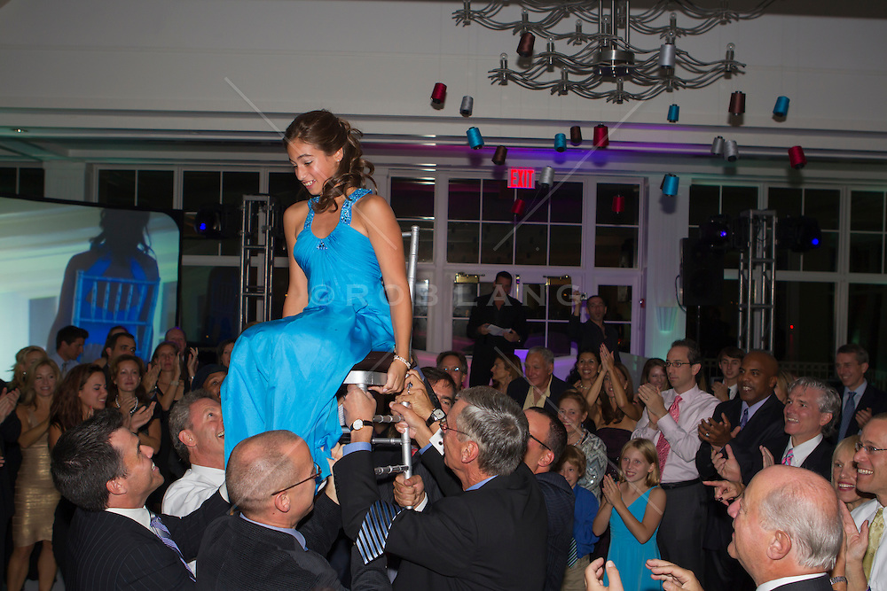 girl being lifted up on a chair at her Bat Mitzvah