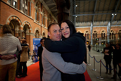 © Licensed to London News Pictures. 19/01/2012. London, U.K..world's Longest marathon hug attempt at St. Pancras station, London. To celebrate National Hugging Day (21 January) and to signal welcoming the world to London in 2012, London is aiming to break the Guinness World Records title for the world's Longest marathon hug..Huggers are Lorna Tullet, star of the choir, and her husband Sergeant Bryan Tullet..Photo credit : Rich Bowen/LNP