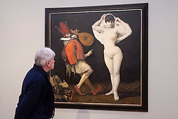Visitor looking at GDR painting, The Jester and the Girl, by Werner Tuebke (Tübke),  at Museum Barberini in Potsdam Germany